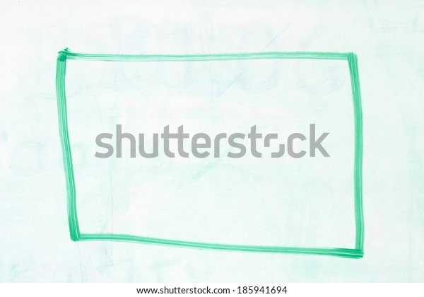 rectangular box outline in green dry erase marker on a used white board