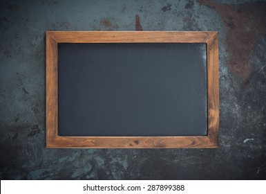 Rectangular chalkboard with copy space isolated on dark metal background