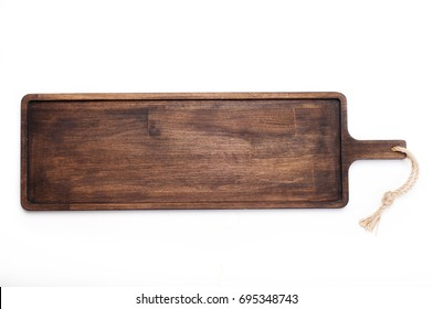 Rectangular cutting board (tray) made of dark wood on a white background. Isolated object.