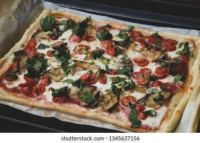 Rectangular shape and thick hand made romana's pizza traditional italian pizza margherita closeup.