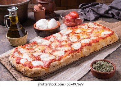 Rectangular shape and thick hand made romana's pizza
