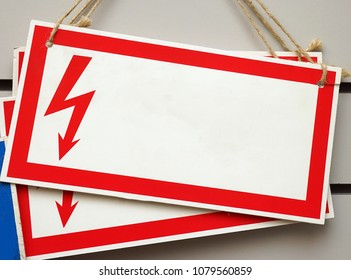 Rectangular sign with a red border and zipper. Electrical hazard. Empty template.