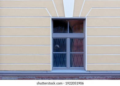 Rectangular window against a yellow plastered wall. From a series of windows of St. Petersburg.