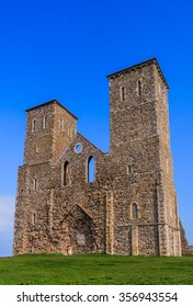 Reculver Towers facade from bottom of embankment.