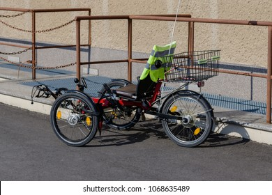 A recumbent in front of a house