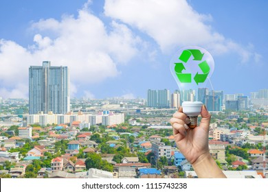 recyclable environment human hands holding light bulb with
