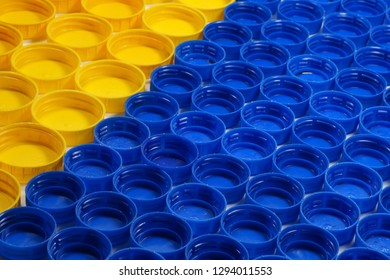 Recyclable materials. Bottle caps made of HDPE (high-density polyethylene) segregated according to the colors prepared for recycling.