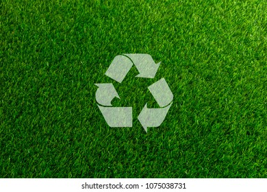 Recyclable Symbol a green on grass background