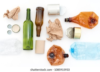 Recyclable waste, resources. Clean glass, paper, plastic and metal on white background. Recycling, reuse, garbage disposal, resources, environment and ecology concept
