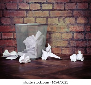 Recycle bin filled with crumpled papers. Brick wall background. Retro style