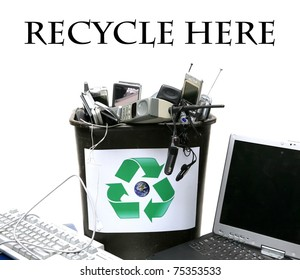 """recycle bin filled with old """"e-waste"""" for recycling of out dated computers, cell phones and related items,  isolated on white with room for your text"""
