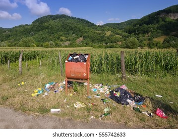 recycle bin and garbage on ground, nature scene landscape