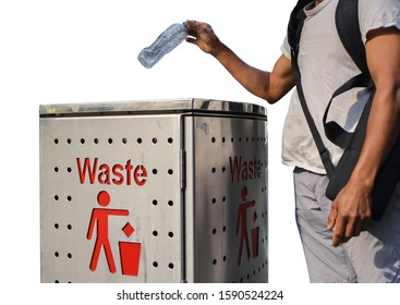 Recycle bin sign male Asian traveller dressing a white t- shirt, gray pant, carrying a black bag standing placing empty plastic water bottle into waste bin with white background