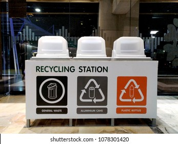 Recycle bins, categorized by materials, sign on each bin is easy for people to understand
