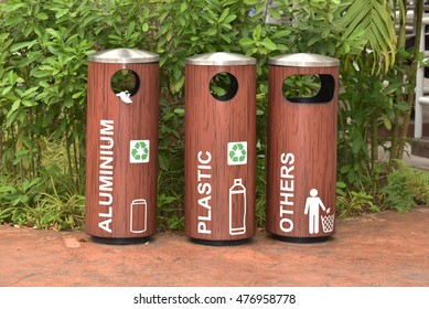 Recycle Bins At A Park For Collection Of  Different Materials