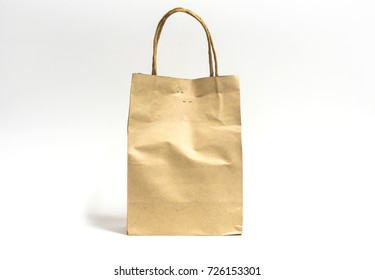 Recycle brown paper bag on white background.