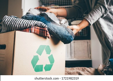 Recycle clothes concept. Recycling box full of clothes. - Shutterstock ID 1721982319