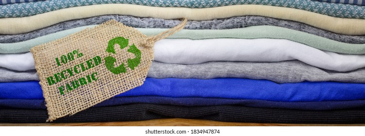 Recycle clothes icon on fabric label with 100% Recycled text. Sustainable fashion and ethical shopping banner heading