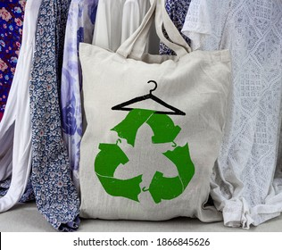 Recycle clothes symbol on reusable fabric bag, reuse, swap, donate, recycle clothes for sustainable fashion and reduce waste