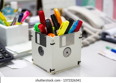 recycle floppy disk, Creative objects used for Store supplies such as pen pencils Scissors in a box on the table in work office, concept recycle floppy disk