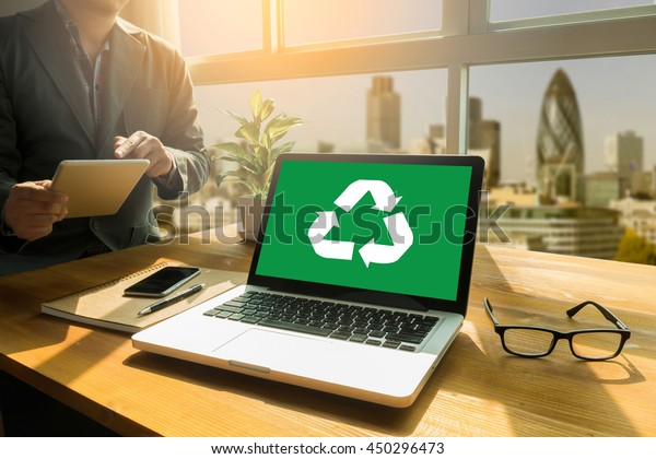 Recycle Green bio eco forest saving environment harmony ecosystem conservation csr esg campaign Thoughtful male person looking to the digital tablet screen, laptop screen,Silhouette and filter sun