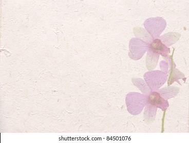 recycle paper with beautiful orchid flower background