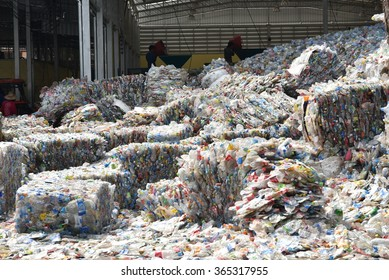 Recycle plastic bottle stack to conveyor line . Plastic recycling industry is recovering scrap or waste plastic from recycle bin to useful products. pile of reused the bin material for manage ecology.