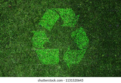 Recycle sign grass background