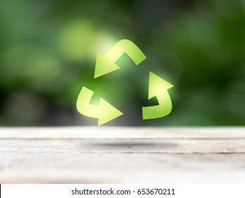recycle symbol on blur background, ecology and environment concept, photographic mixed with illustration