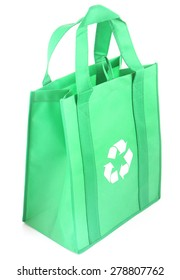 Recycle symbol on reusable shopping bag on white background