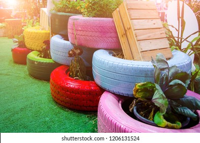 Recycle tires wheel on yard, paint the color used flowerpot,plant vegetables for decorated the garden with sunlight.Concept create value from the waste.