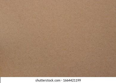 Recycled brown packing cardboard sheet texture. Boxing carton.