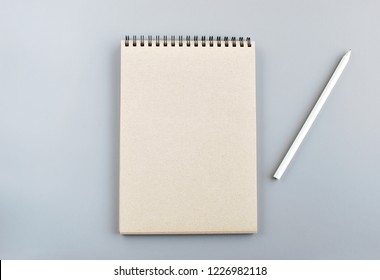 Recycled brown paper notebook and pencil, mock up.