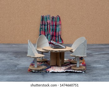 Recycled cardboard furniture. Cardboard chairs and cardboard table, curtains in a living room.