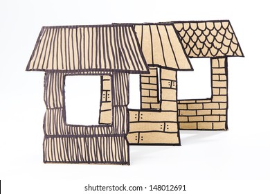 Recycled cardborad made houses / Straw, sticks and briks houses made with cardboard.