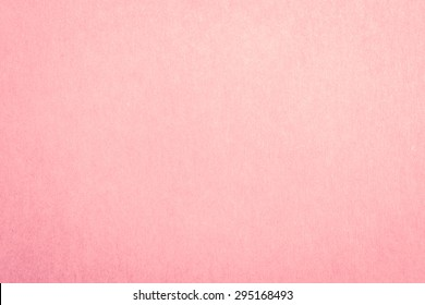 Recycled craft paper textured background in light pink old rose color
