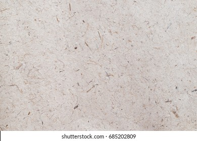 Recycled mulberry rice handmade paper textured in white brown old rough pattern.
