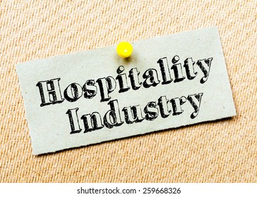 Recycled paper note pinned on cork board. Hospitality Industry Message. Concept Image