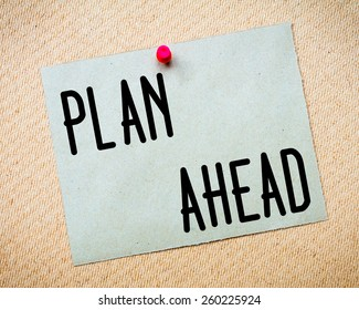 Recycled paper note pinned on cork board. Plan Ahead Message. Concept Image