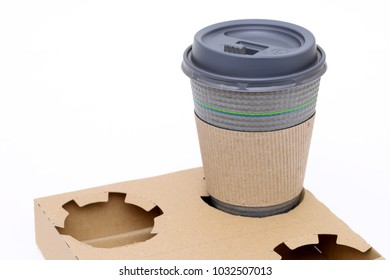 Recycled paper pulp carrier for coffee cup on white background