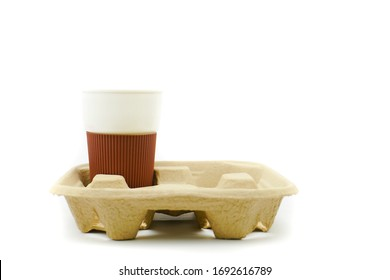 Recycled Paper Pulp Carrier For Coffee Cups On White Background