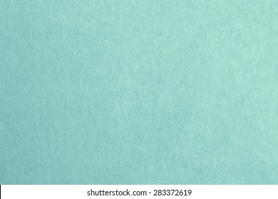 Recycled paper texture background in turquoise green blue mint vintage color