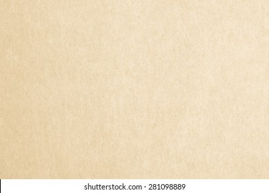 Recycled paper texture background in yellow cream color tone
