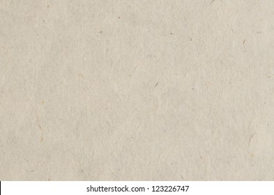 Recycled paper texture closeup background.