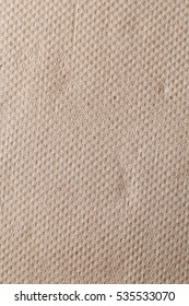recycled toilet paper, light rough textured spotted blank copy space background.