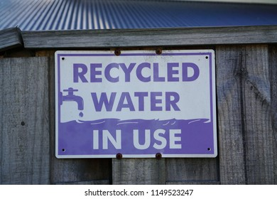 Recycled Water In Use Purple Color Signage in front of a house gate