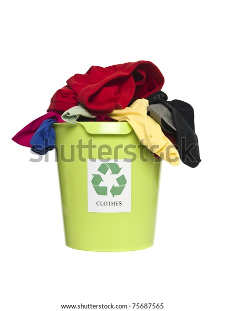 Recycling bin with clothes and fabric isolated on white background