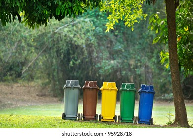 Recycling bin in park for protect environment.Colour of trash contains different type of garbage.Make it easy for waste control. Recycling way save the world for non polluting,environmentally-friendly