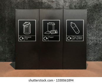recycling bins with Icelanding signs in a building in iceland