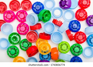 Recycling - collecting plastic. Colorful drink caps.